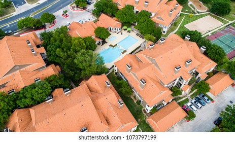 Orange roofs on New development Townhomes in Austin , Texas , USA - Aerial View - large apartment buildings with bright orange tops
