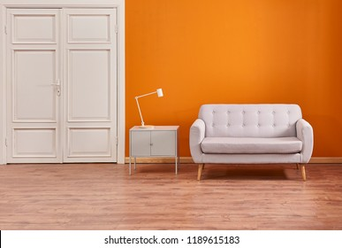Orange room classic white door and sofa interior living room.