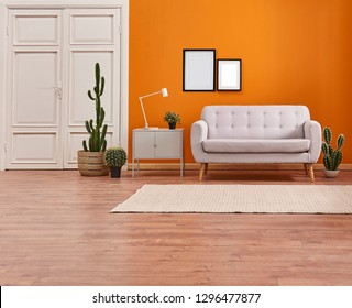 Orange room, orange wall and background, sofa, carpet and white door concept with frame and picture.