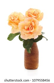 Orange roses in a vase isolated on a white background.