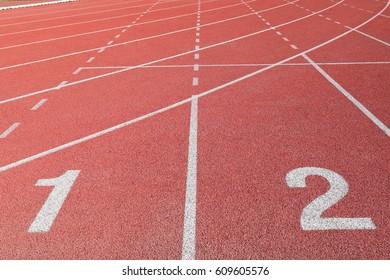Orange running Red track on background
