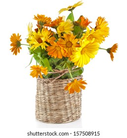orange  rural bouquet heap of calendula in wicker box close up Isolated on white background
