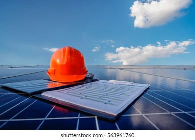 A orange safety cap and check chart on the solar cell board.