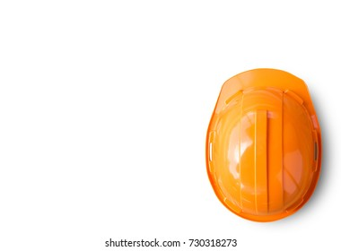 Orange safety engineer helmet isolated on white background. top view with copy space for design.