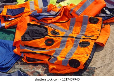 Orange safety vest with reflective strips gear