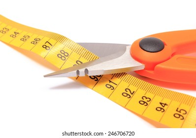 Orange scissors cutting tape measure on white background, concept for slimming
