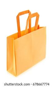 Orange shop bag of origami, isolated on white background.