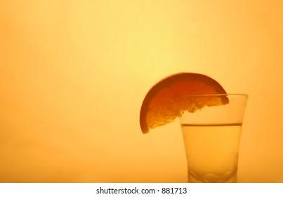 orange and shot glass