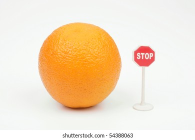 Orange and sign stop on a white background