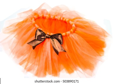Orange skirt tutu with brown bow on a white background
