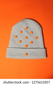 orange skittles on a hat