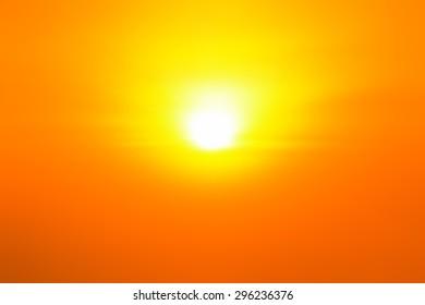 Orange sky with bright sun shining in twilight