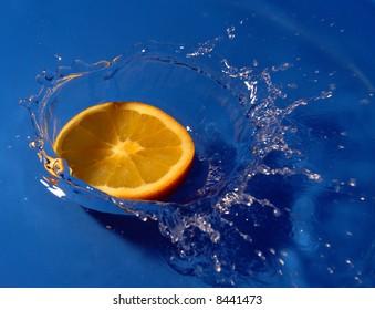 Orange slice in blue water