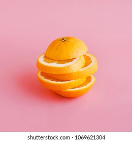 Orange slice on pastel color background.Summer and healthy concept idea