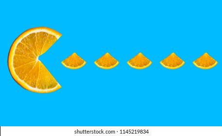 orange slice, Pac man, isolated on blue background
