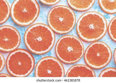 Orange sliced on a blue rustic wood table