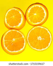 Orange slices on a yellow background close-up