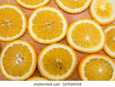 orange slides for the background. Sliced orange on a wooden background. View from above. Beautiful background with orange slices.