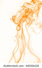 Orange smoke on white background, orange ink background, movement of orange smoke