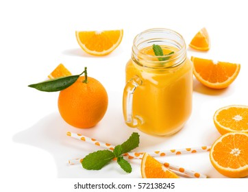 Orange smoothie and orange fruits with green leaves isolated on white background.