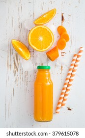 Orange smoothie on rustic wood background, copy space, top view