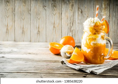 Orange Soda Creamsicle cocktail. Ice Cream and orange smoothie. Dreamsicle drink. Rustic wooden background copy space