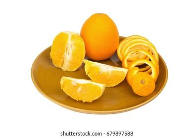 orange Spiral peel half slice on dish isolated on white background.