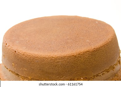 orange sponge cake over white background