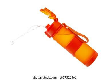 Orange sports water drinking bottle. Isolated on a white background. Floating water bottle.