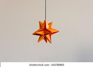 An orange star of Origami