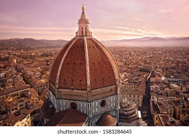 orange sunrise of the dome of Florence Cathedral or the Cattedrale di Santa Maria del Fiore or Duomo in Florence Italy