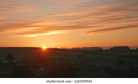 Orange sunrise over aberystwyth mountains