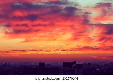 Orange sunset and cloud over cityscape Kiev, Ukraine, Europe