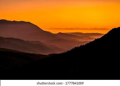 Orange sunset in mountain landscape