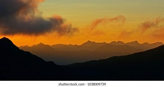 Orange sunset and mountain range