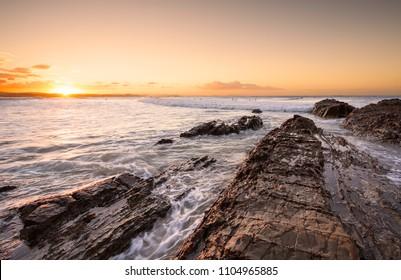 Orange sunset on the rocks at Snapper Rocks, Coolangatta, Australia