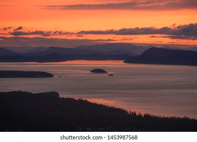 Orange Sunset from Orcas Island, San Juan Islands, Puget Sound, Vancouver Island, Gulf Islands, archipelago. Washington State, Vancouver Island, British Columbia, Canada.