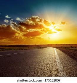 orange sunset over asphalt road