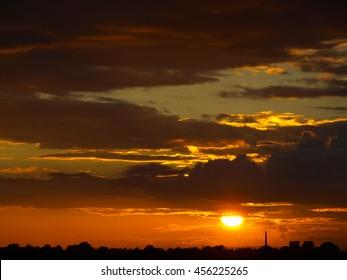 Orange Sunset over Carlisle in Cumbria - Silhouette of City