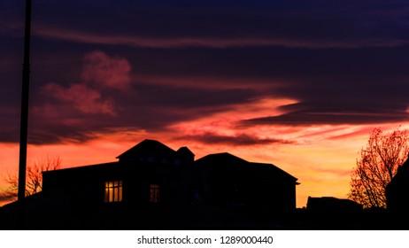 Orange Sunset Over The Hosue