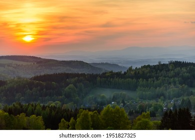 An orange sunset over Orlicke hory and Krkonose mountains in the distance.  - Shutterstock ID 1951827325