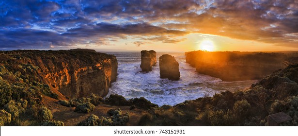Orange sunset over sea horizon off Loch Ard lookout on Great Ocean road Twelve apostles marine park in Victoria, Australia.