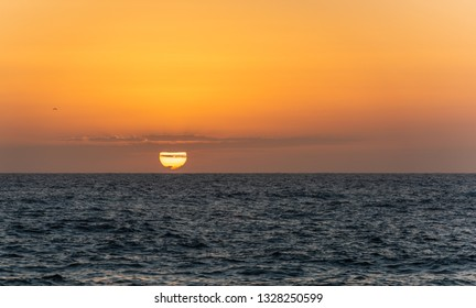 Orange sunset over the sea. Travel background.