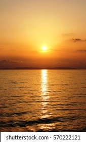Orange sunset with reflection over the Meditarranean Sea