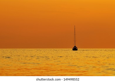 orange sunset with silhouette of a boat