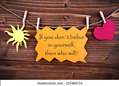 Orange Tag Or Label With Sun And Heart On A Line With Life Quote If You Dont Believe In Yourself Then Who Will On Wooden Background, Two Symbols, Vintage, Retro And Old Fashion Style With Frame