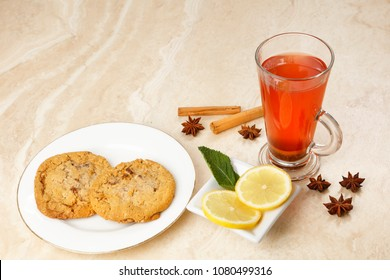 Orange Tea  infusion with blackcurrants ginger, hibiscus, rosehip and spices with cookies, with copy space