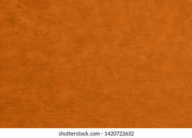 Orange textured leather material to use as a texture for your images or text or a background