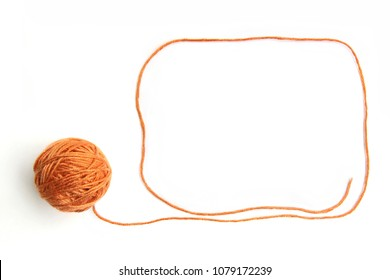 Orange thread ball with frame made of thread isolated on white background. Cotton thread ball with empty frame.