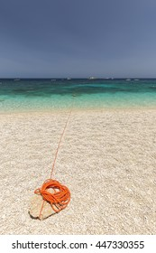 orange thread on dream beach of sardinia